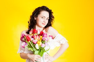 Beautiful woman with tulips in hand