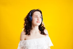 Girl wearing wireless headphones,