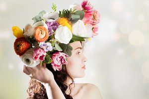 Beauty woman with flowers hairstyle
