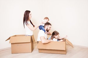 Family in boxes at new home
