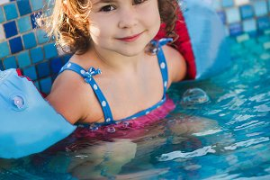 Girl in armlets the swimming pool