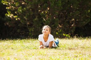 Teenage girl lying on the grass