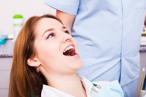 Young woman visit the dentist