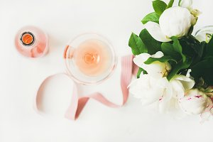 Greeting card concept with rose wine and flowers, horizontal composition