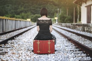 woman in the train tracks