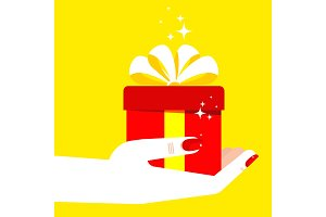 woman hand holding gift yellow