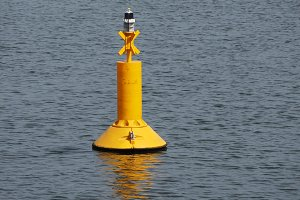 yellow buoy floating in the sea