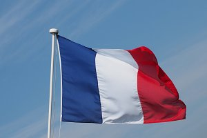 French Flag of France over blue sky