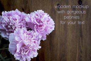 Beautiful pink peonies at wood