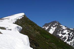 Snowy ridge in the mountains.