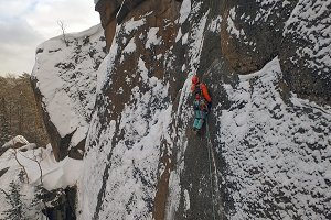 Aerial shot of the lone climber on the wall.