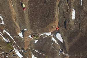Top view of the climbers climbing the mountain.