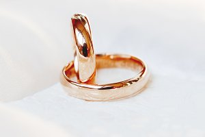 Wedding rings on white silk