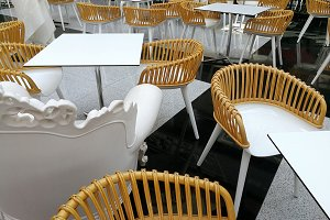 Chairs and tables on a terrace