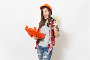 Young crazy woman in protective hardhat holding opened case with instruments or toolbox and toy hammer and screaming isolated on white background. Instruments for renovation room. Repair home concept.