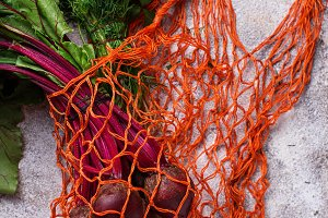 Fresh vegetable in fishnet bag