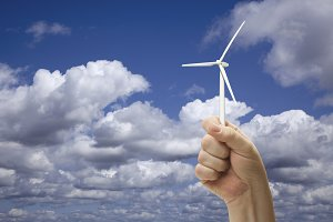 Male Fist Holding Wind Turbine