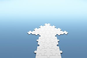 Jigsaw puzzle in the form of an arrow on blue background in business concept, 3d illustration