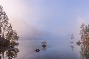 Foggy lake and mountain