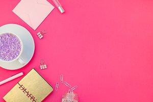 Styled pink feminine workspace flat