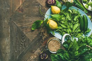 Spring healthy vegan food cooking ingredients, wooden background, copy space