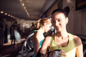 Detail, attractive woman in gym after running on treadmill