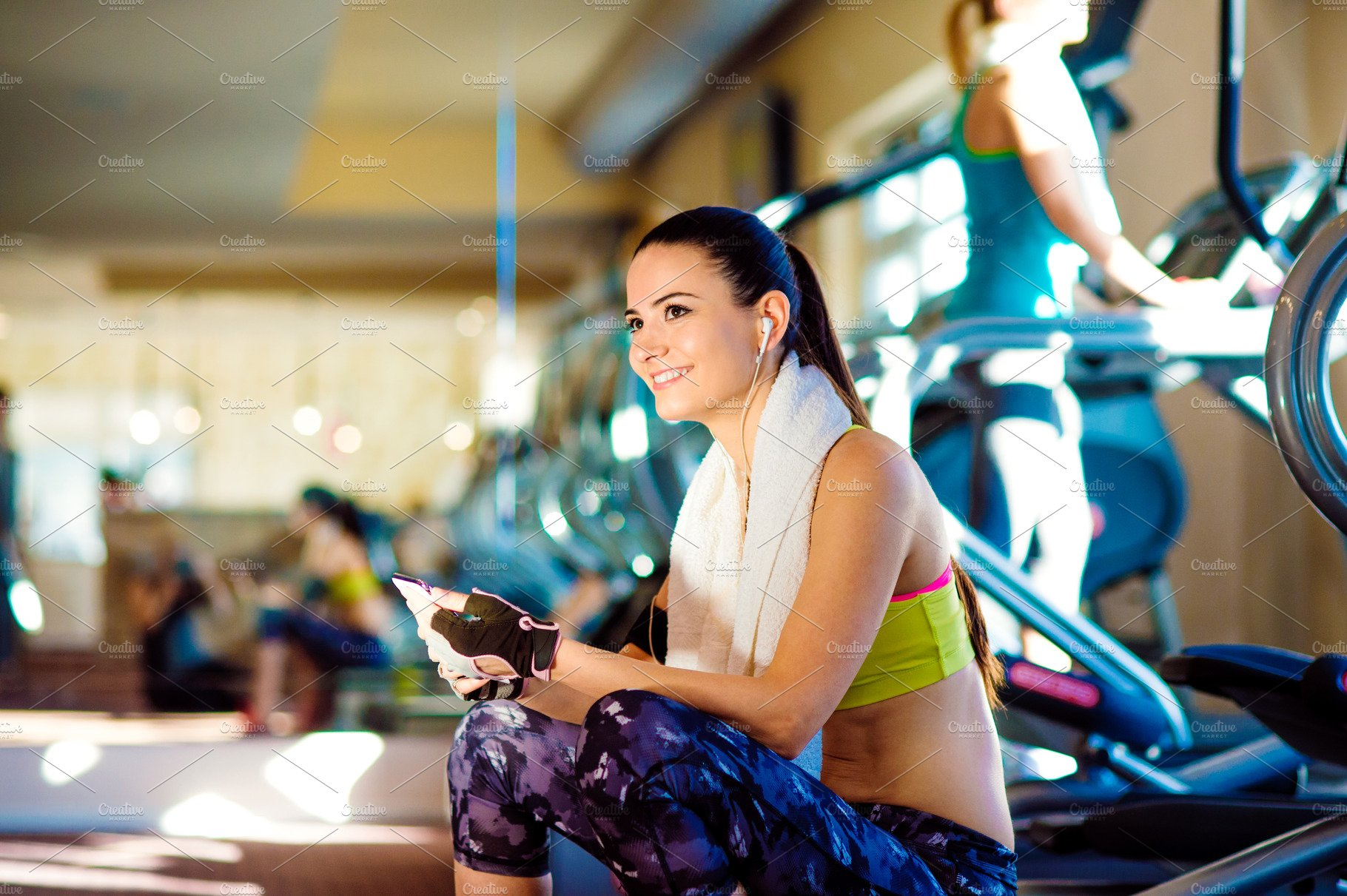 Attractive Fit Women In A Gym With Smart Phone High Quality People Images Creative Market Hatred has no place here. attractive fit women in a gym with smart phone