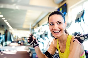 Attractive fit woman in a gym taking a break