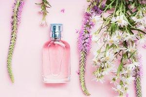 Pastel floral perfume bottle