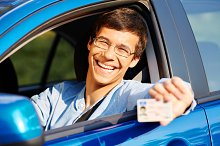 Guy shows driving license from car
