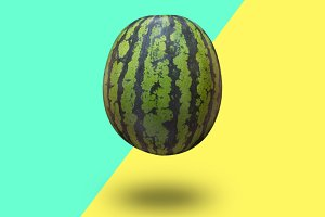 Watermelon isolated on a blue green and yellow background with a shadow