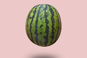Watermelon isolated on a pink pastel background with a shadow