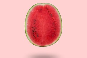 Cutted watermelon isolated on pink background with a shadow