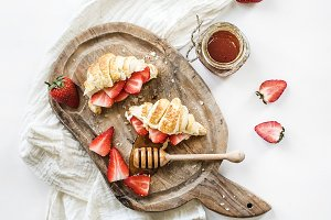 Freshly croissants with strawberries