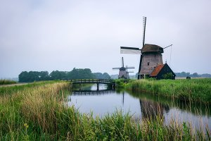 Old dutch windmill in cold morning scenery near Amsterdam