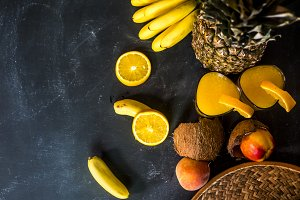 black dark tropical fruits. vegan raw fresh food on chalkboard