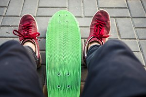 first person view of man sitting on the bench with skateboard