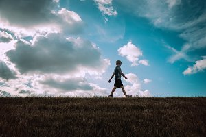 Child Walking on a Hill