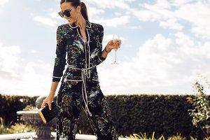Beautiful woman with wine walking