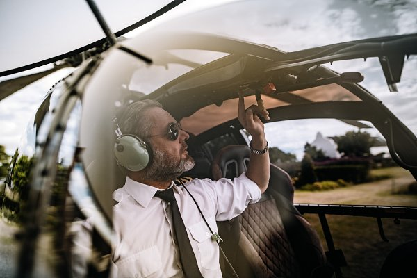 People Stock Photos: Jacob Lund Photography - Pilot starting the controls