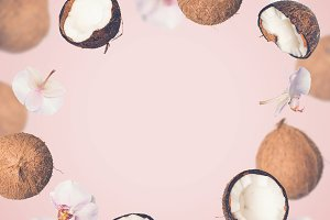 Pink tropical summer background with falling coconuts