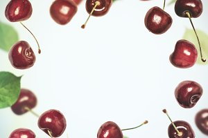 Summer berry square background. Cherry flies frame