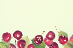 Summer berry cherry banner background. Collage of flying berries