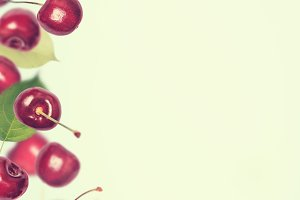 Summer vertical berry  background. Cherry flies  border