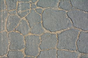 Cracked asphalt.