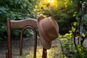 hat on a vintage wooden chair