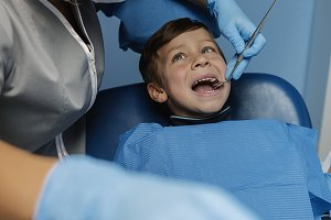 Dentists intervening a patient