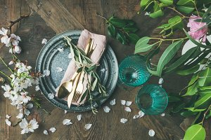Flat-lay of Table setting with spring flowers