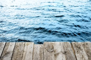 Wooden platform on blue water