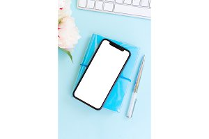 Home office desk with phone on blue